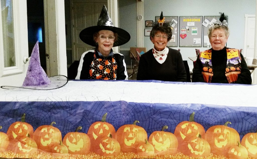 Members await the arrival of the children who trick or treated for UNICEF